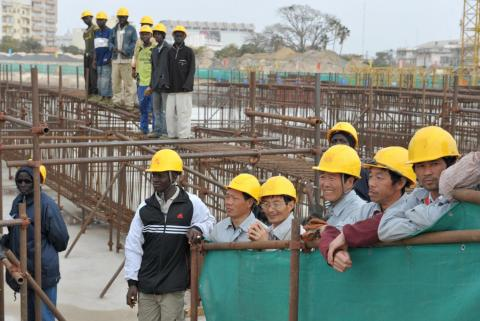 Seneglese and Chinese workers at the construction site for a new national theater in Dakar on