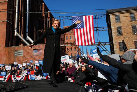 Potential 2020 Democratic presidential nomination candidate U.S. Senator Elizabeth Warren (D-MA) waves at the crowd ahead of a campaign rally in Lawrence
