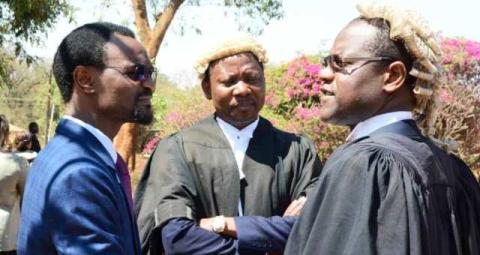 Lawyer Charles Mhango with Samuel Tembenu and Ben Phiri