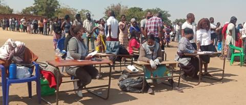 Voters and Mec staff at a polling station
